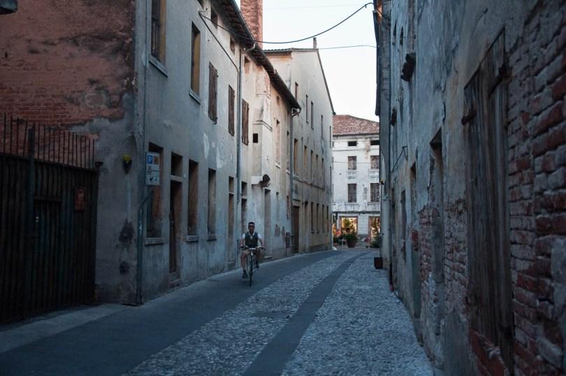 Street with a cyclist, Mediaevil Fair, Castelfranco Veneto, Italy - www.rossiwrites.com