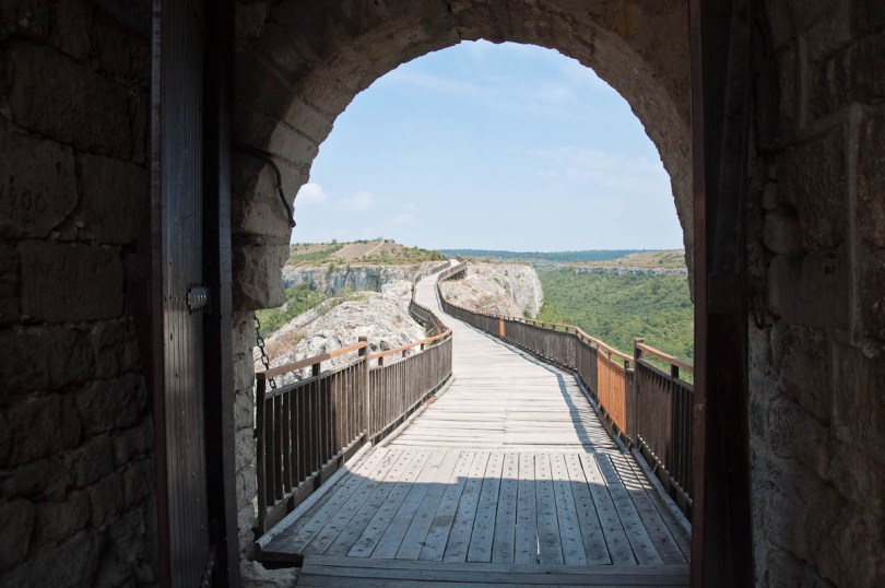 The wooden bridge seen through the gate, Provadia, Bulgaria - www.rossiwrites.com