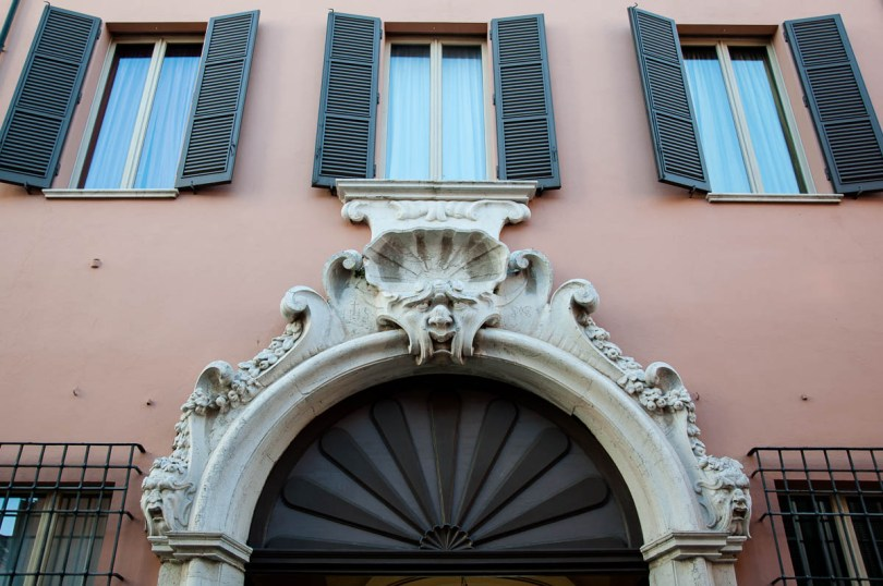 A grotesque face adorning the gate of a large house - Ravenna, Emilia Romagna, Italy - www.rossiwrites.com