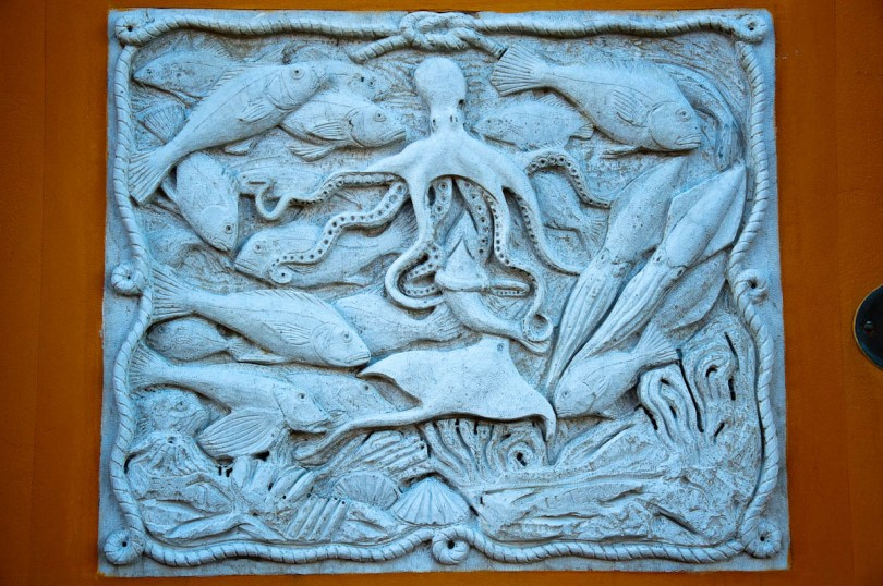 Marine bas-relief on the wall of a house - Chioggia, Veneto, Italy - www.rossiwrites.com