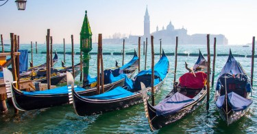 Gondolas with the island of San Giorgio Maggiore in the background - Venice, Italy - www.rossiwrites.com