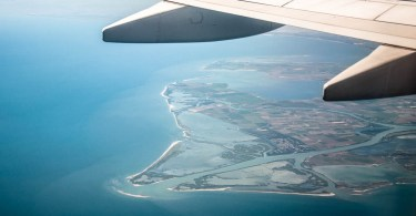 Italy from above - The wing of a plane over the Italian Adriatic coast - www.rossiwrites.com