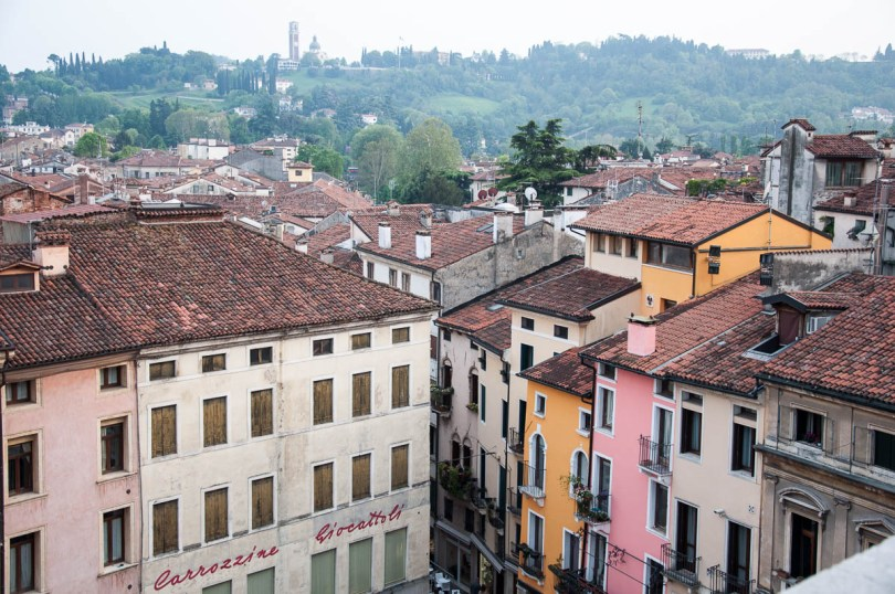 Colourful houses with Monte Berico in the distance - seen from Palladio's Basilica, Vicenza , Italy - www.rossiwrites.com