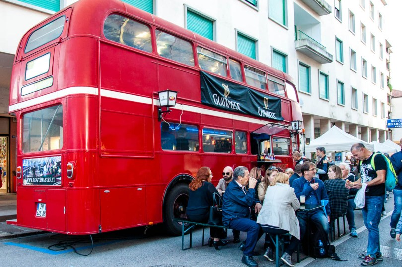 A double-decker bus serving Guiness on tap - British Day Schio - Veneto, Italy - www.rossiwrites.com