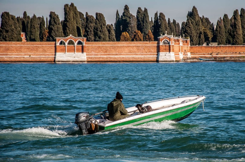 A man and his dog in a boat in the Venetian lagoon - Venice, Veneto, Italy - www.rossiwrites.com