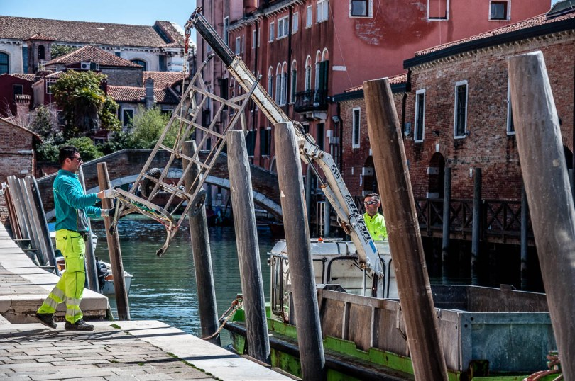 Getting the trolley back on the rubbish collecting boat - Venice, Italy - www.rossiwrites.com