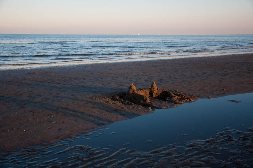 An abandoned sandcastle at the Sottomarina beach at sunset - Chioggia, Veneto, Italy - www.rossiwrites.com