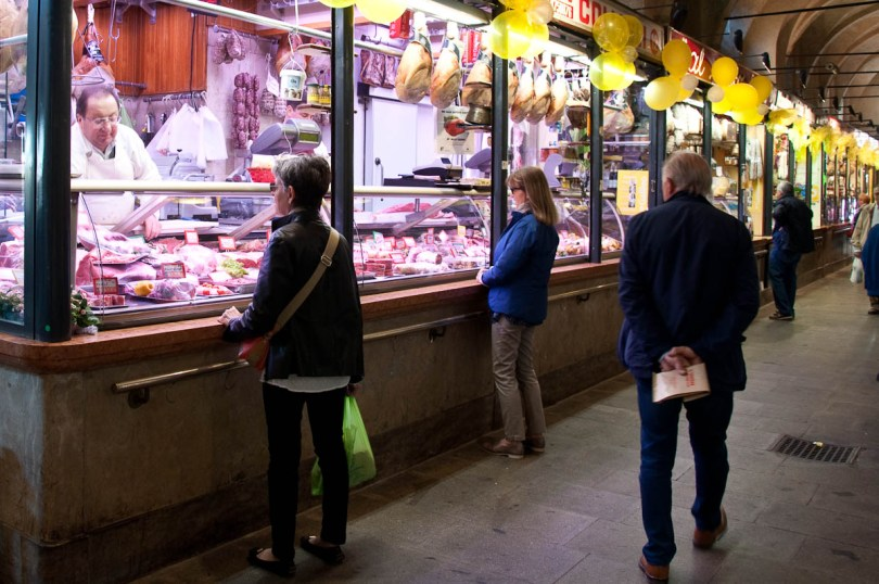 Shopping at the butcher's on the ground floor of Palazzo della Raggione, Piazza delle Erbe, Padua, Italy - www.rossiwrites.com