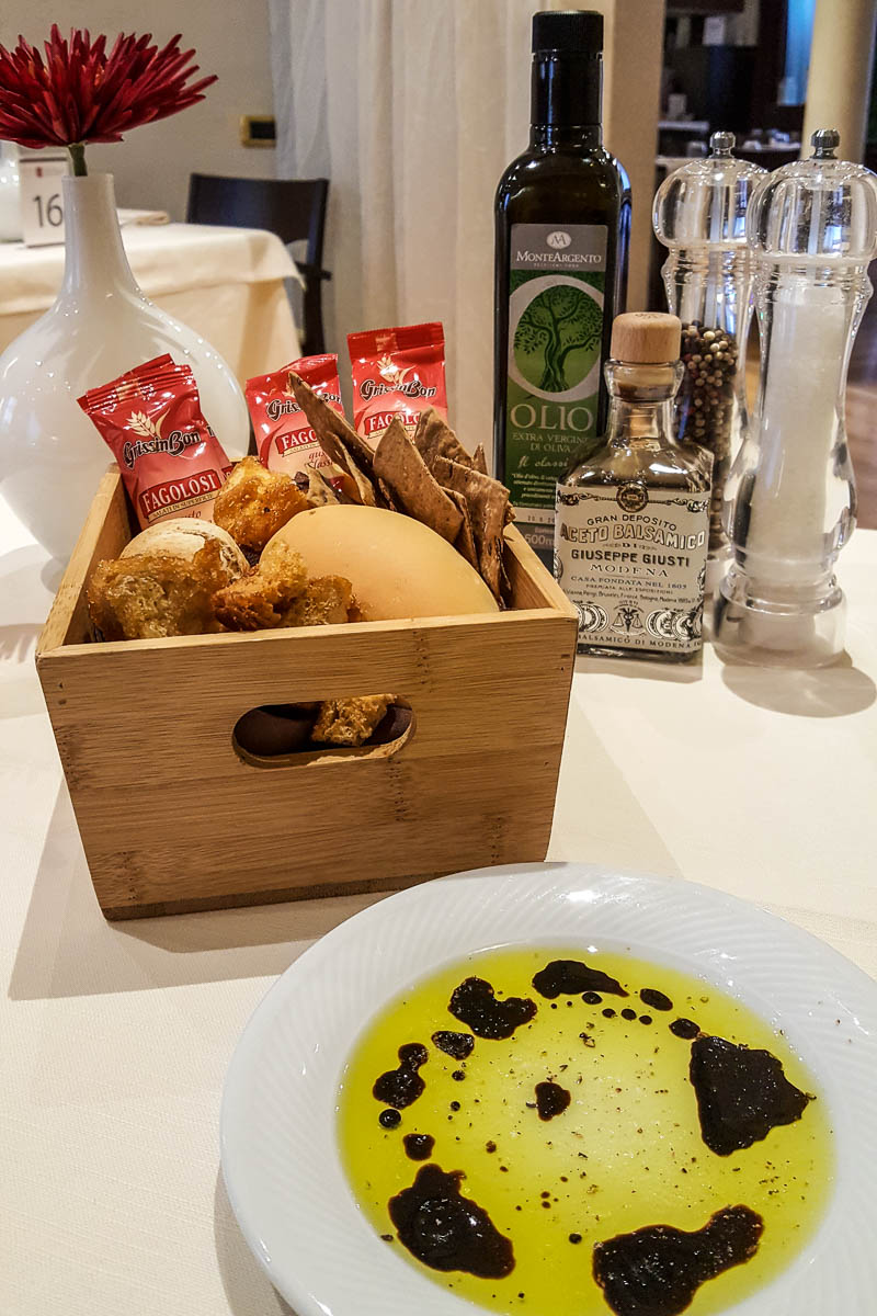 A bread basket with a plate with olive oil and balsamic vinegar - Restaurante Mezzaluna - Hotel Viest, Vicenza, Italy - www.rossiwrites.com