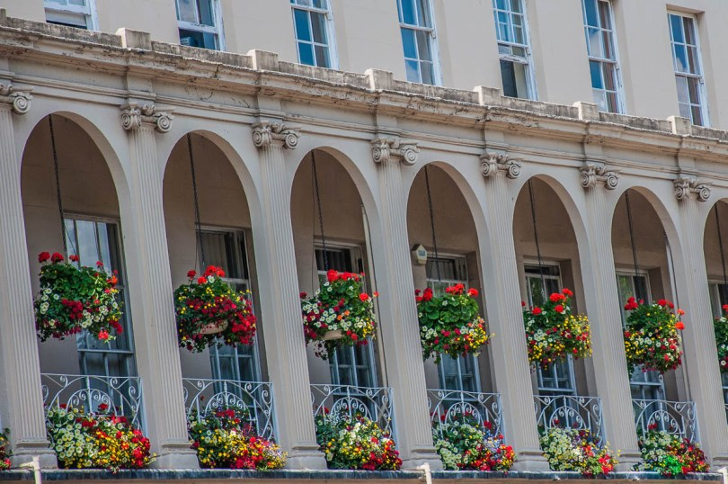 A facade dripping with flowers in bloom - Cheltenham, England - www.rossiwrites.com