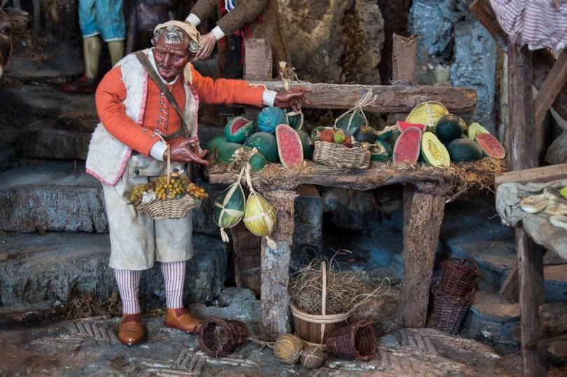 A fruit seller, Detail of a Nativity Scene - Palazzo della Raggione, Padua, Veneto, Italy - www.rossiwrites.com