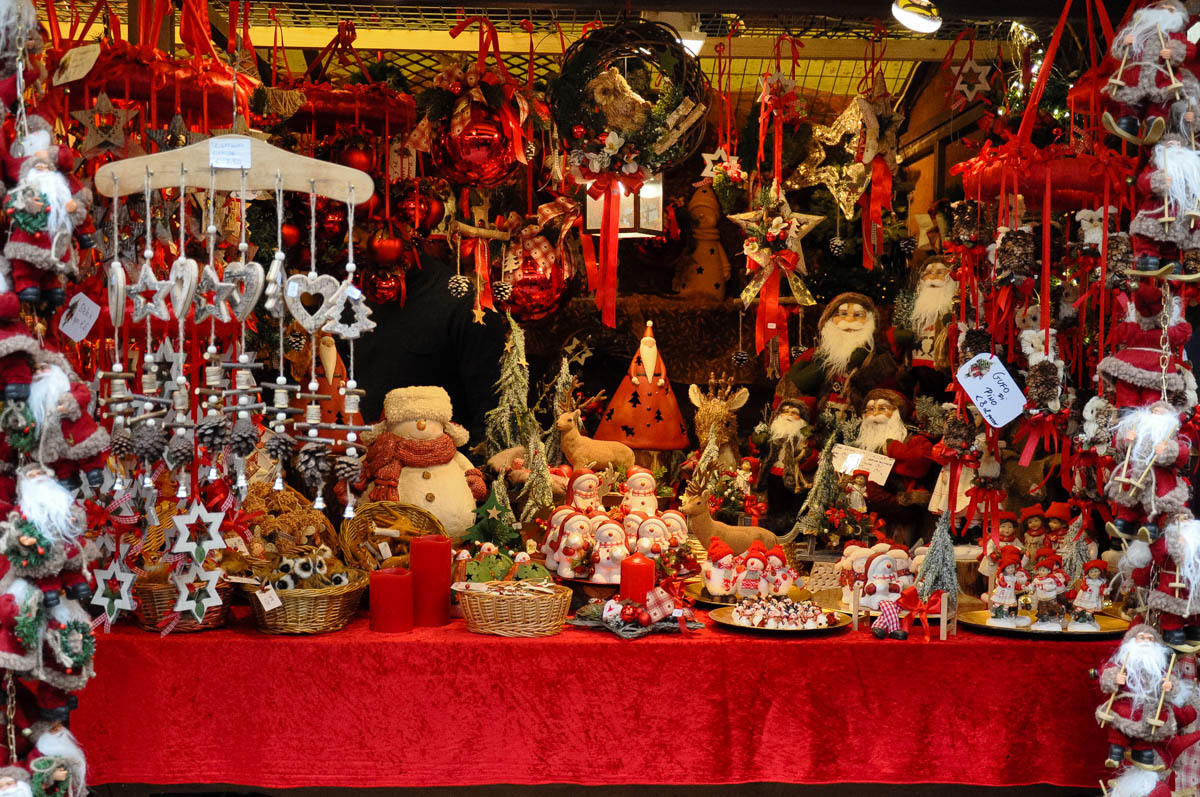 Christmas In Italy Decorations.A Stall Selling Red And White Christmas Decorations