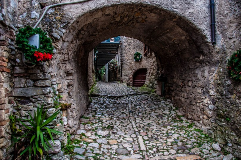 A cobbled street and a stone passage - Campo di Brenzone, Lake Garda, Italy - www.rossiwrites.com
