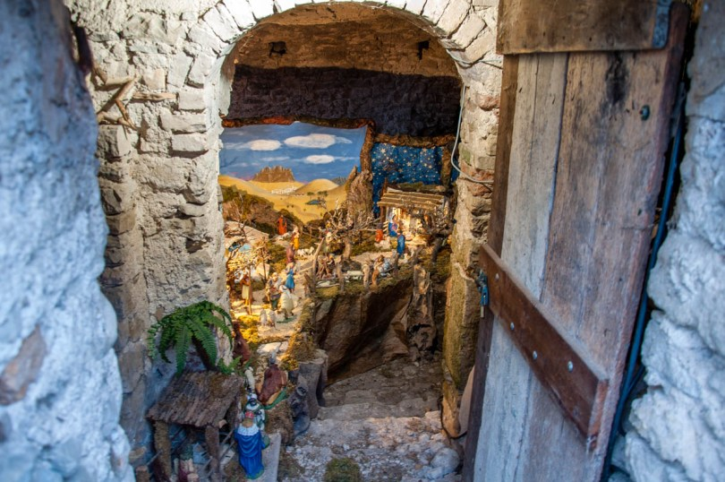 An open door and steps leading to an intricate Nativity Scene - Campo di Brenzone, Lake Garda, Italy - www.rossiwrites.com