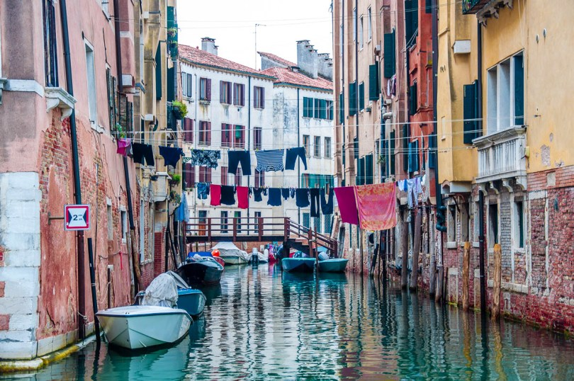View of a canal with houses and clotheslines - Venice, Italy - www.rossiwrites.com