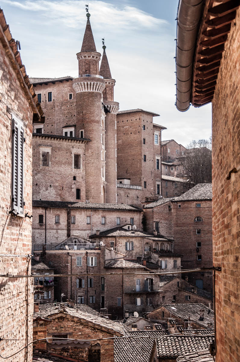 The Ducal Palace with rooftops - Urbino, Marche, Italy - www.rossiwrites.com
