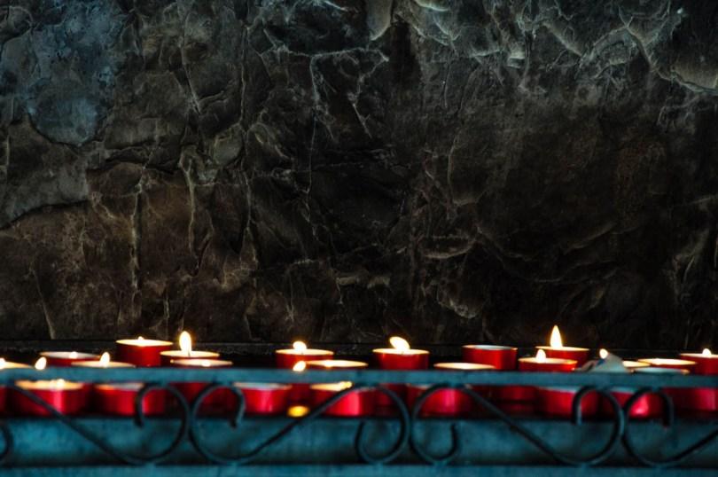 Lit candles - Sanctuary of Madonna della Corona - Spiazzi, Veneto, Italy - www.rossiwrites.com