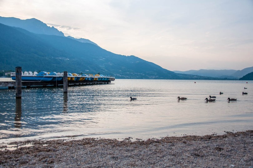 A view of Lake Caldonazzo with paddle boats and ducks in the late evening - Trentino, Italy - rossiwrites.com