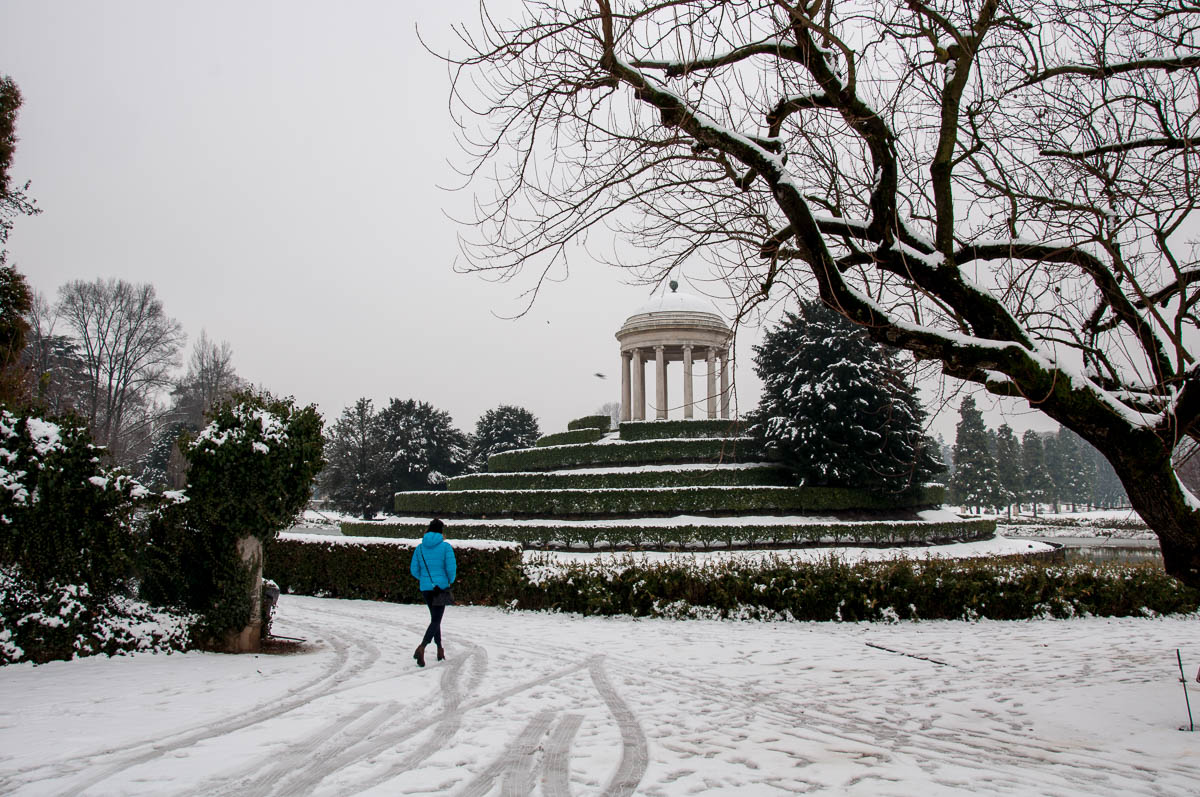 A woman in a blue jacket in the white snow - Parco Querini, Vicenza, Veneto, Italy - rossiwrites.com