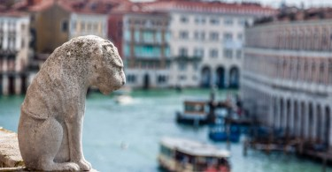 A statue of a lion overlooking the Grand Canal - Venice, Italy - rossiwrites.com