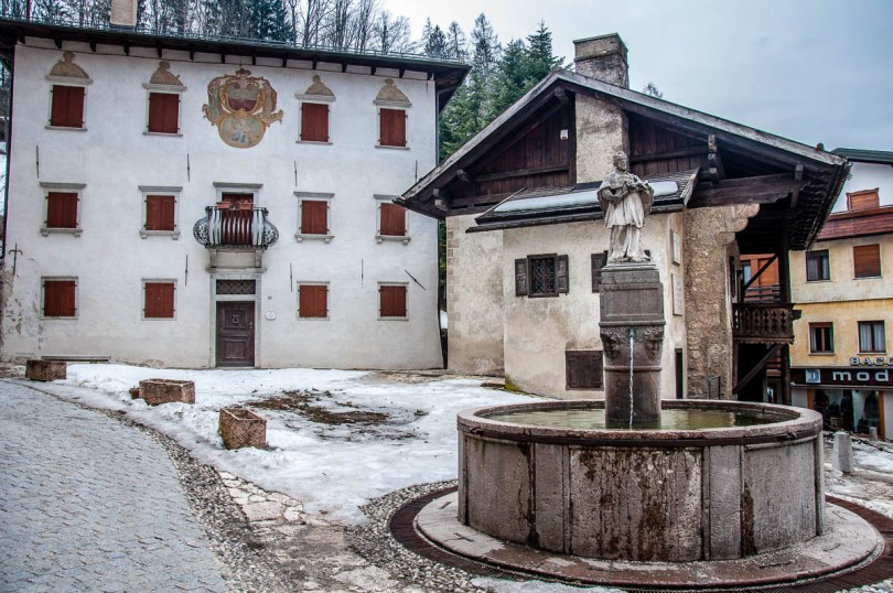 Side view of Titian's birth house with a fountain and a 16th-century palace - Pieve di Cadore - Province of Belluno, Veneto, Italy - rossiwrites.com