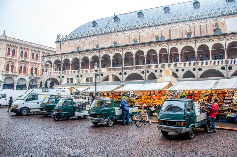 The fleet of Apes serving the daily market at Piazza delle Erbe - Padua, Veneto, Italy - rossiwrites.com