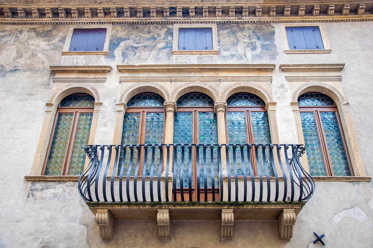 Windows with faded frescoes - Padua, Veneto, Italy - rossiwrites.com