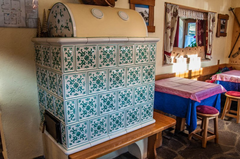 The traditional stove in front of Agritur Malga Rolle - Dolomites, Trentino, Italy - rossiwrites.com