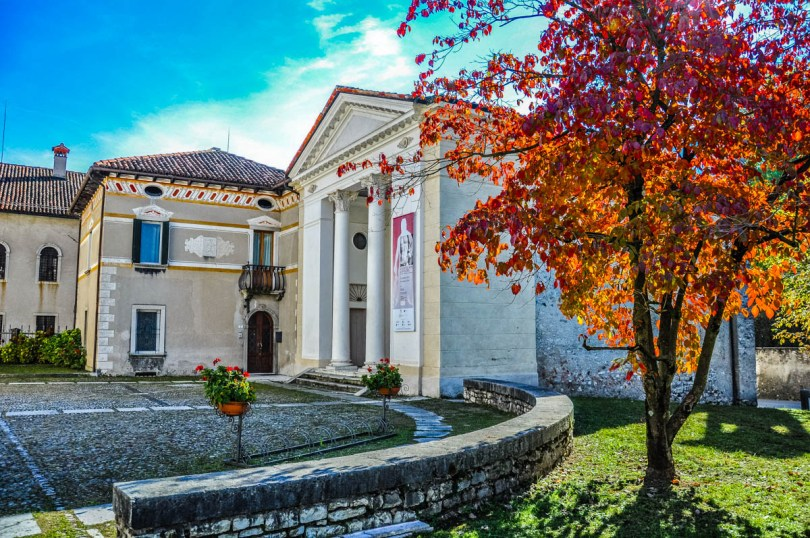 View of Feltre with red autumnal tree - Feltre, Veneto, Italy - rossiwrites.com