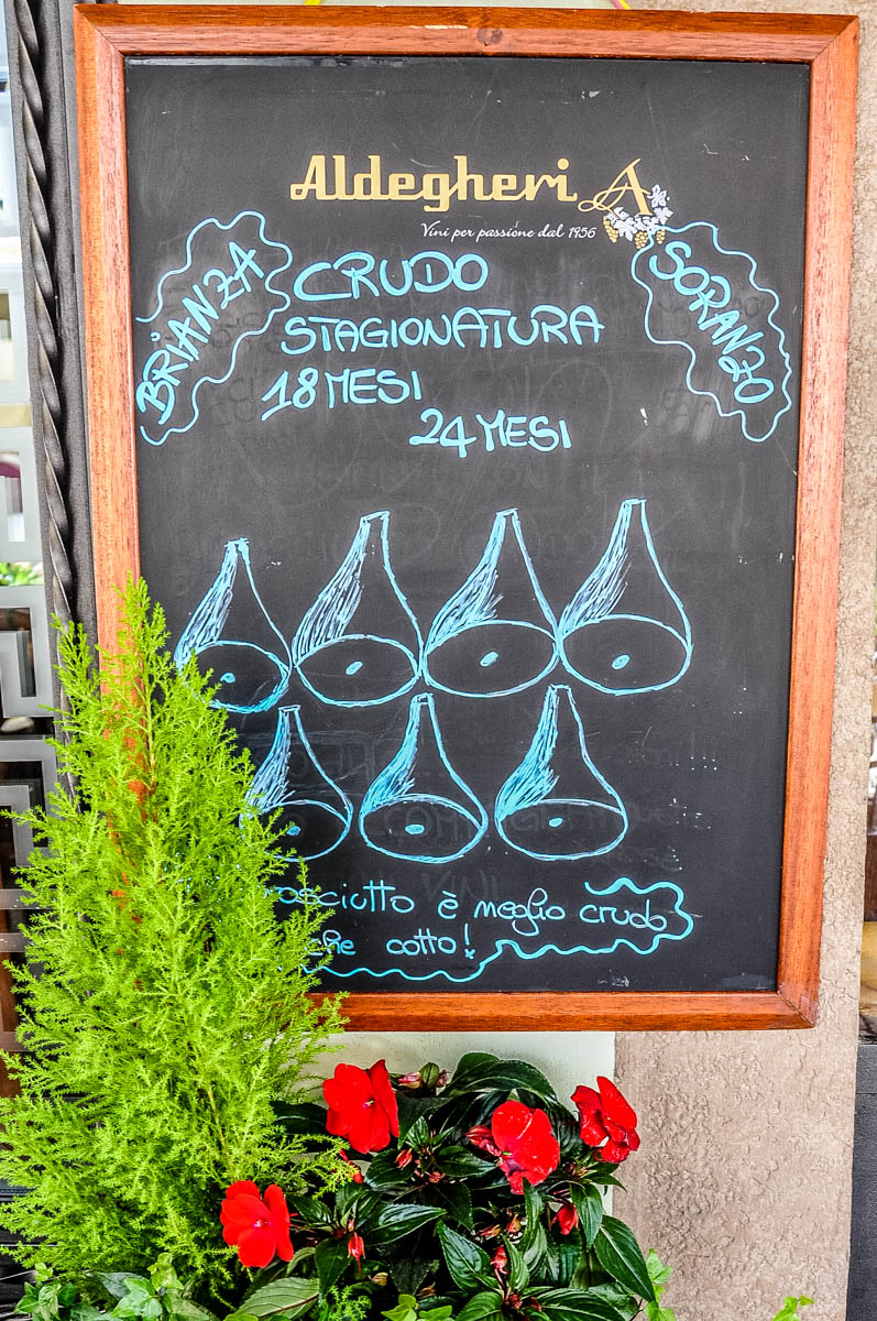 A chalkboard advertising the local prosciutto - Montagnana, Veneto, Italy - rossiwrites.com
