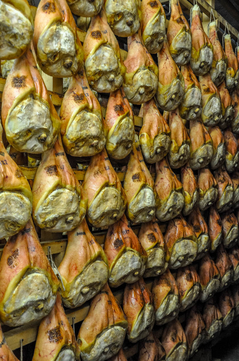 Rows of prosciutto hams being dry cured the traditional way - Montagnana, Veneto, Italy - rossiwrites.com