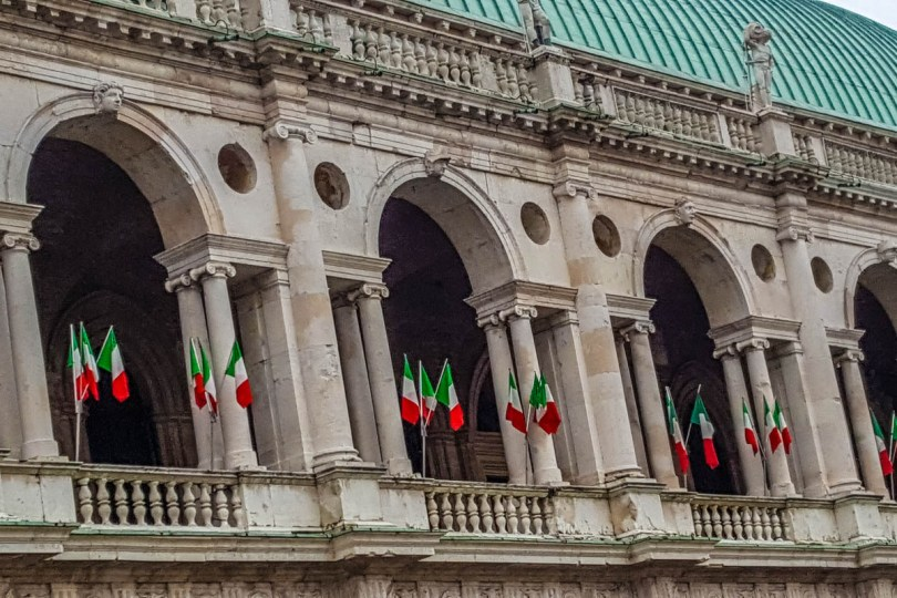 The Basilica Palladiana adorned with Italian flags - Vicenza, Italy - rossiwrites.com