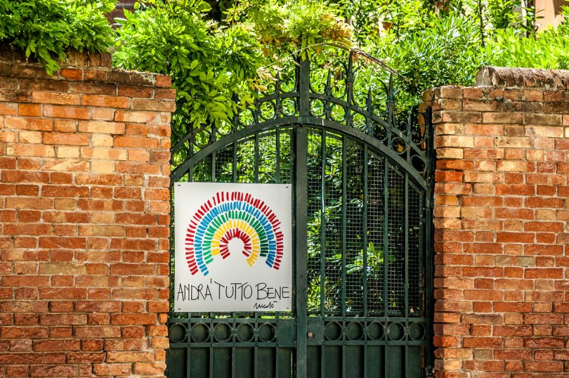 Gate with an Andra Tutto Bene poster - Venice, Italy - rossiwrites.com