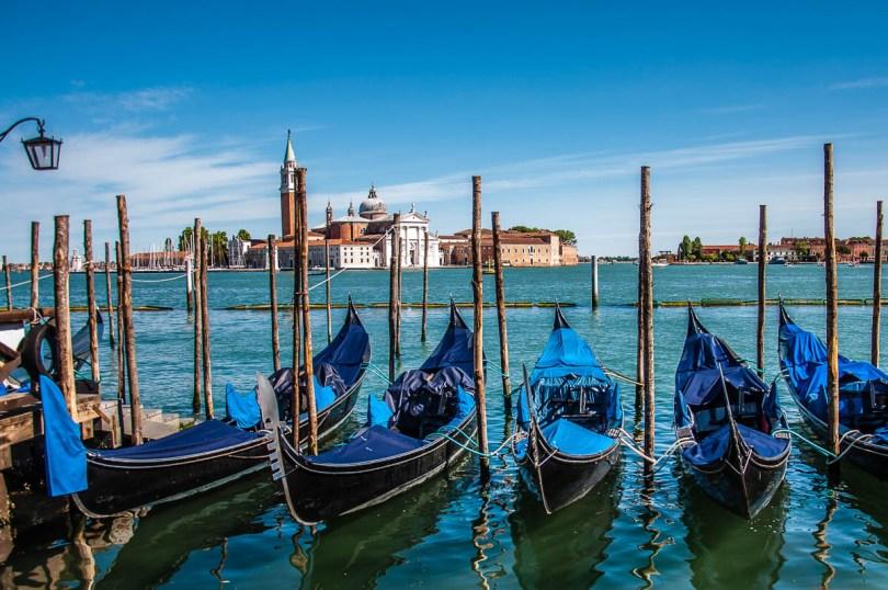 Gondolas and the island of San Giorgio Maggiore - Venice, Italy - rossiwrites.com