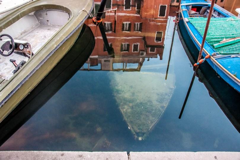 Piazzale Perotolo with a ghost boat, Chioggia - Veneto, Italy - rossiwrites.com