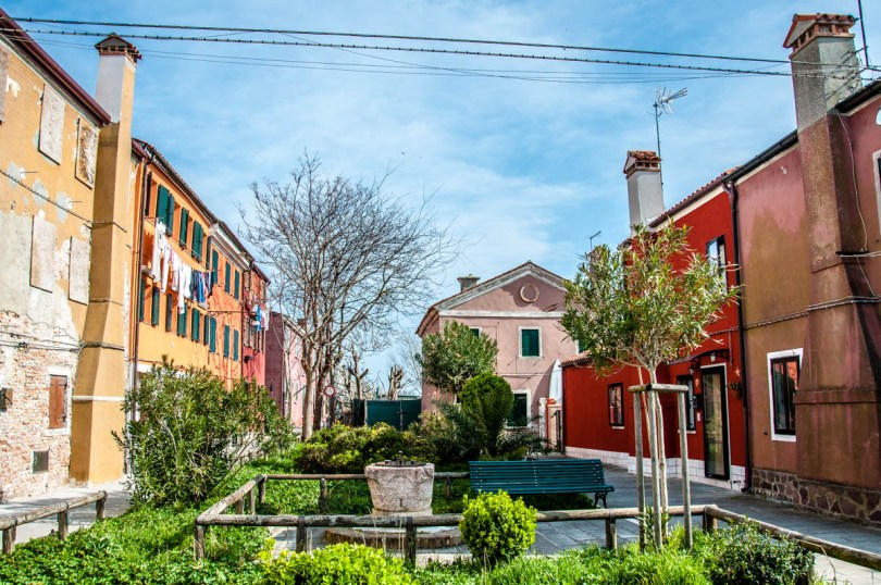 Small square with colourful houses - Pellestrina, Veneto, Italy - rossiwrites.com
