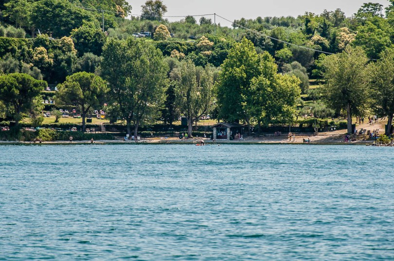 Baia delle Sirene seen from the water - Lake Garda, Italy - rossiwrites.com
