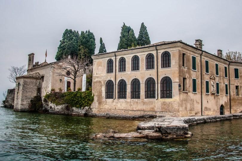 Locanda di San Vigilio and the church seen from the water - Punta di San Vigilio - Lake Garda, Italy - rossiwrites.com