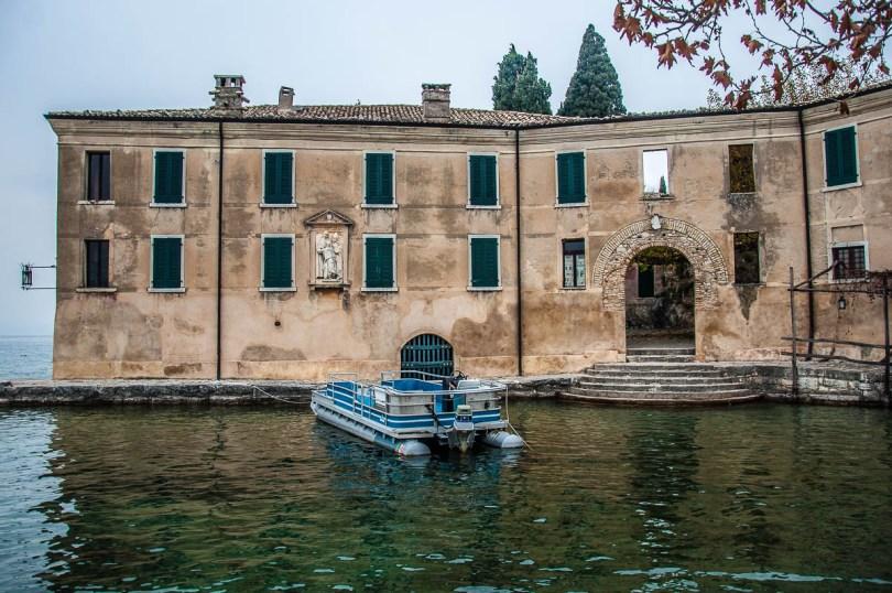 Locanda di San Vigilio with the boat for guests - Punta di San Vigilio - Lake Garda, Italy - rossiwrites.com