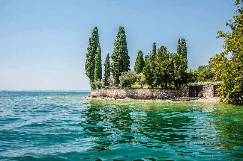 Parco di San Vigilio seen from the water - Lake Garda, Italy - rossiwrites.com