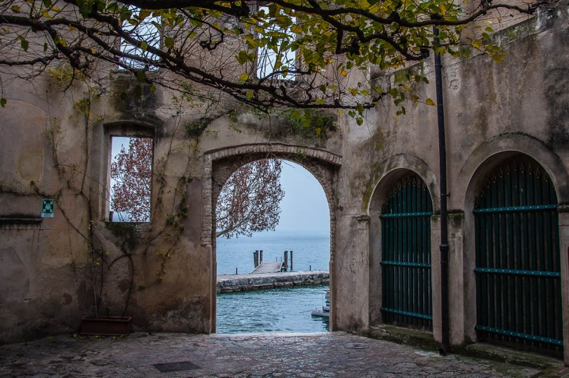 The arched gateway leading to the small harbour - Punta di San Vigilio - Lake Garda, Italy - rossiwrites.com