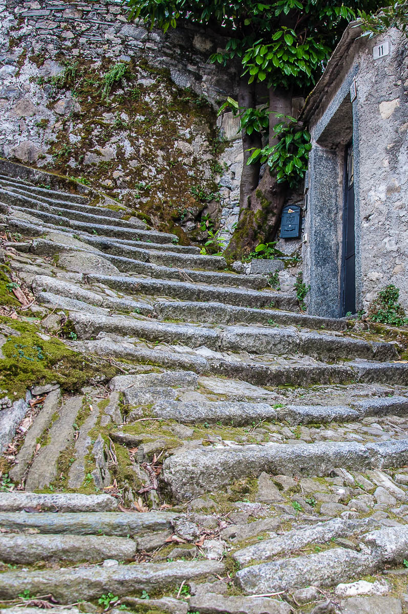 Steep stairs with a house door - Nesso - Lake Como, Italy - rossiwrites.com