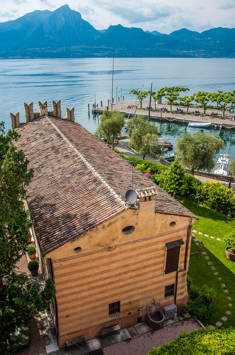 The view from the battlements of the Scaliger Castle with the historic harbour - Torri del Benaco, Italy - rossiwrites.com