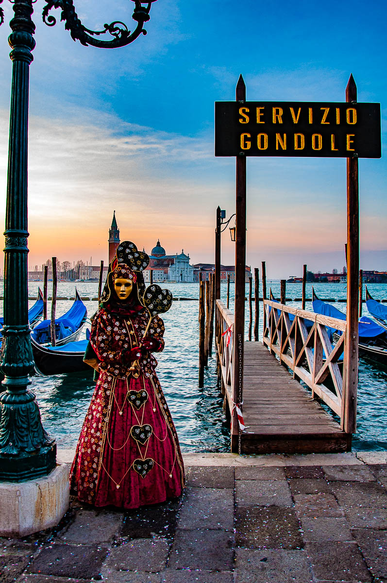 A beautiful Venetian mask standing in front of the island of San Giorgio Maggiore - Venice, Italy - rossiwrites.com