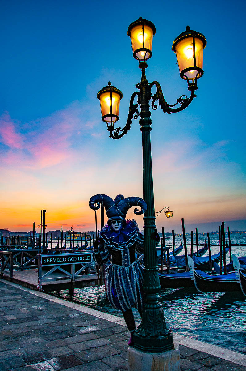 A beautiful Venetian mask under a blue and pink dawn - Venice, Italy - rossiwrites.com