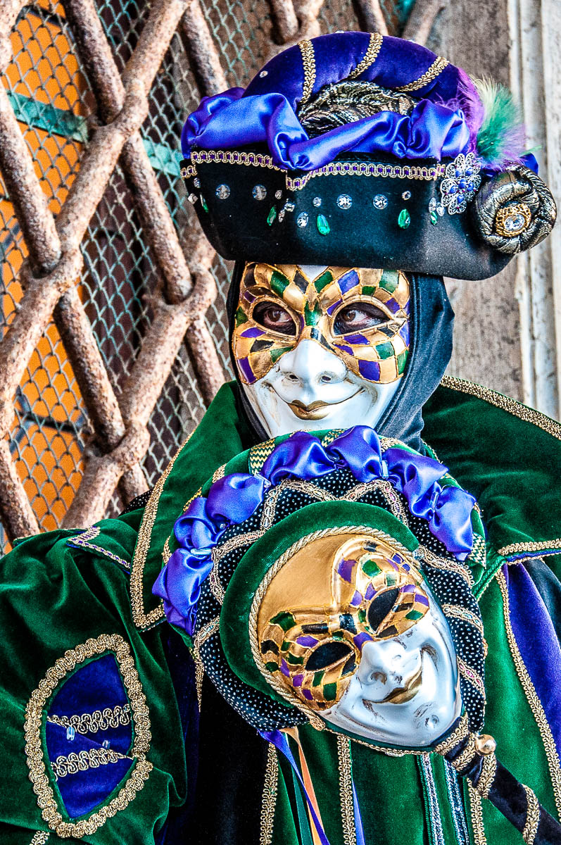 A fun mask in the portico of the Doge's Palace - Venice, Italy - rossiwrites.com