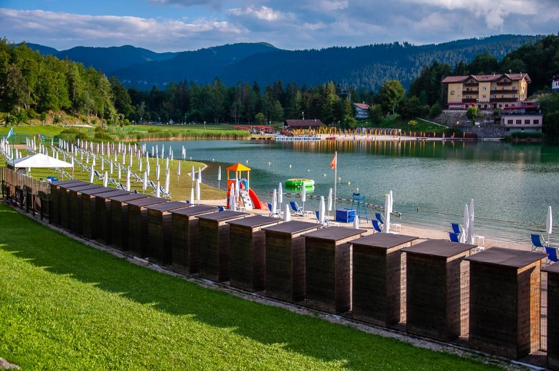Beach huts lined along the beaches of Lake Lavarone - Trentino, Italy - rossiwrites.com