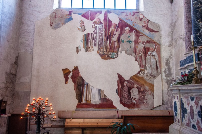 Damaged fresco inside the Cathedral of San Andrea Apostolo - Venzone, Italy - rossiwrites.com
