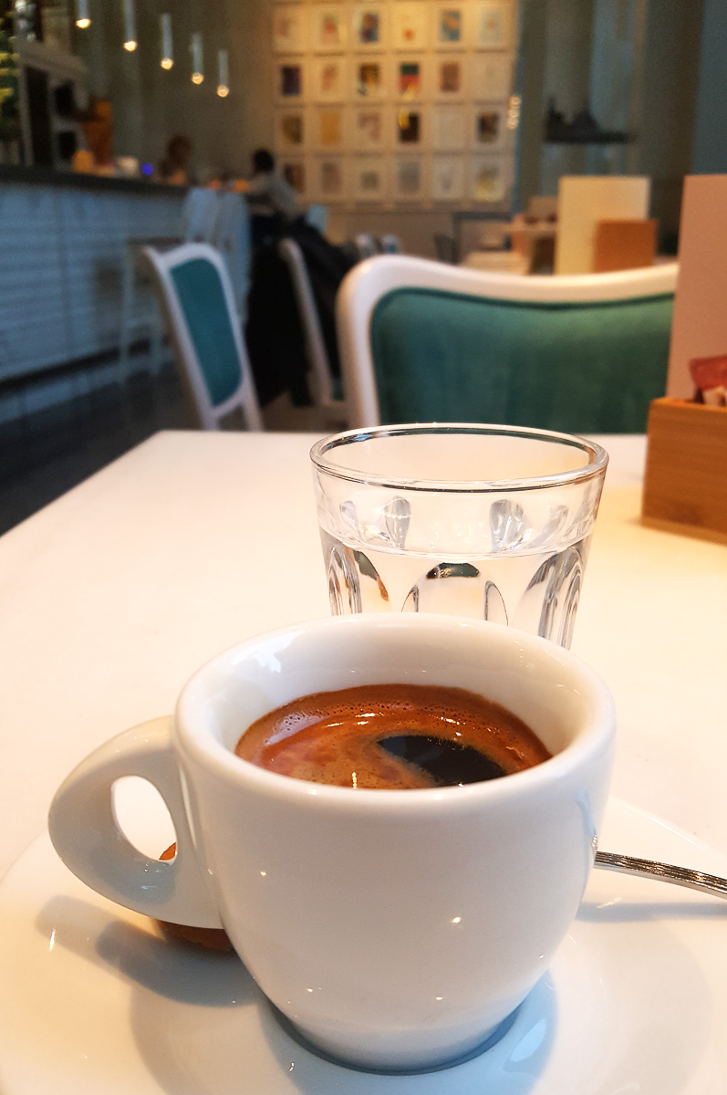 Espresso served with a glass of water - Vicenza, Italy - rossiwrites.com