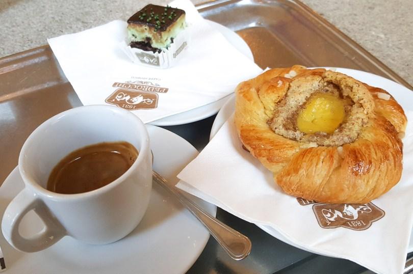 Espresso served with a pastry and a tiny Pedrocchi cake - Caffe Pedrocchi - Padua, Italy - rossiwrites.com